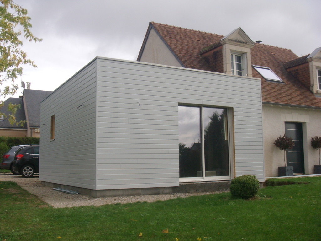 Extension maison ossature bois en kit maison en bois for Extension maison